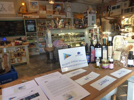 Andros Island shop display of sail transported goods, bilingual brochures