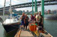 Part of the farm-bike-boat delivery team at last year's Village Building Convergence on the dock at OMSI.